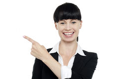 Charming brunette lady pointing copy space Stock Photo