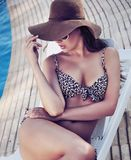 Charming brunette relaxing Stock Photo