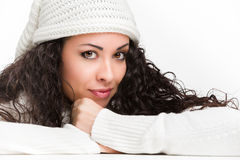 Charming brunette smiling. Charming brunette with big brown eyes smiling on white background Royalty Free Stock Photo
