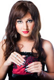 Charming brunette with theatrical red handbag Royalty Free Stock Photography