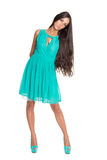Charming brunette in a turquoise dress Stock Photos