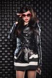 Charming brunette wearing black jacket Stock Photo