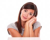Charming brunette with wishing gesture smiling Stock Images