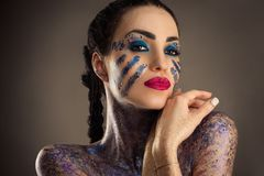 Charming brunette woman with blue makeup Stock Photo