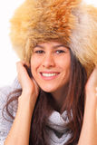 Charming brunette woman in a fur hat. Charming young brunette woman in a fur hat Royalty Free Stock Photos