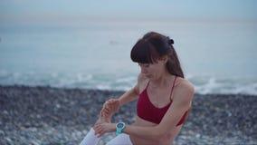 Woman doing yoga on beach alone stock footage