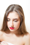 Charming brunette young woman with red lips closed eyes & naked shoulders on white background Royalty Free Stock Photo