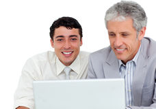 Charming business co-workers using a laptop Royalty Free Stock Images