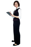 Charming business lady posing with a clipboard Stock Photography
