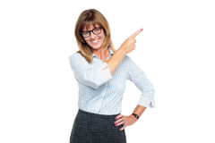 Charming business professional pointing away Royalty Free Stock Photography