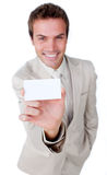 Charming businessman holding a white card Stock Photography