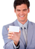 Charming businessman holding a white card Royalty Free Stock Photos