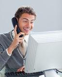 Charming businessman on phone at his desk Stock Image