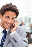Charming businessman phoning in his office Stock Images