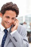Charming businessman phoning in his office Royalty Free Stock Photo