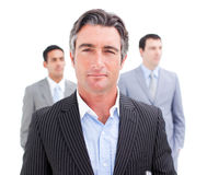 Charming businessman posing in front of his team Royalty Free Stock Photography