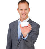 Charming businessman showing a white card Stock Photo