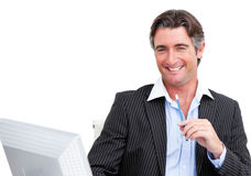 Charming businessman working at a computer Royalty Free Stock Photography
