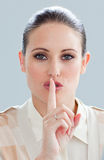 Charming businesswoman asking for silence Stock Photography