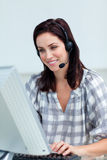 Charming businesswoman with headset on Royalty Free Stock Image