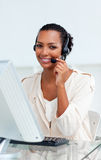 Charming businesswoman with headset on Stock Images