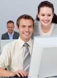 Charming businesswoman helping her colleague Royalty Free Stock Images