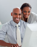Charming businesswoman helping her colleague Royalty Free Stock Photography