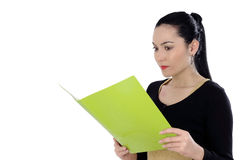 Charming businesswoman holding a folder. Beautiful and attractive businesswoman who read the file. isolated Royalty Free Stock Photos