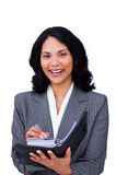 Charming businesswoman making notes on her agenda. Isolated on a white background Stock Photography