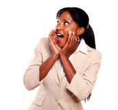 Charming businesswoman screaming and looking right. Charming businesswoman screaming and looking to her right on isolated background Stock Image