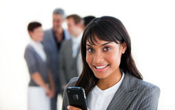 Charming businesswoman sending a text Royalty Free Stock Image