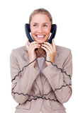 Charming businesswoman tangled up in phone wires Stock Photography