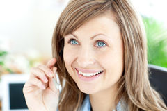 Charming businesswoman wearing earpiece Royalty Free Stock Images