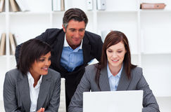 Charming businesswomen and their colleague working Stock Images