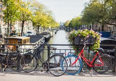 Free Charming Canal With Boat Houses And Bicycles In Amsterdam Old Town, Netherlands. Popular Travel Destination And Tourist Attraction Stock Photo - 164458080