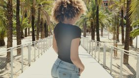 Charming casual woman on street in sunshines stock video footage