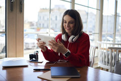 Charming casually dressed smiling hipster girl with headphones stock images