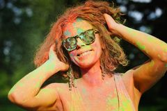 Charming caucasian model in glasses covered by dry Holi paint. Charming caucasian woman in glasses covered by dry Holi paint royalty free stock photo