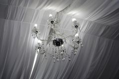 Charming chandelier with white lights. Charming chandelier from a wedding room black and white colours. beautiful royalty free stock photos