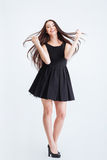 Charming cheerful woman with beautiful flying long dark hair Royalty Free Stock Images
