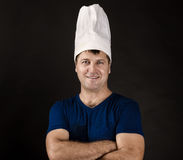 Charming chef posing on black Royalty Free Stock Photos