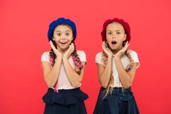 Charming and chic. Cute girls having the same hairstyle. Small children with long hair plaits. Fashion girls with tied royalty free stock photo