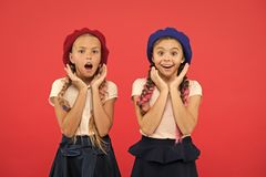 Charming and chic. Cute girls having the same hairstyle. Small children with long hair plaits. Fashion girls with tied stock photos