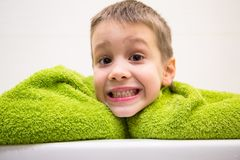 Charming child in bathroom stock photography