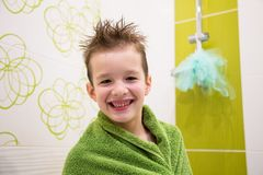 Charming child boy in bathroom stock images