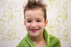 Charming child boy in bathroom stock image