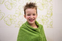 Charming child boy in bathroom royalty free stock photography