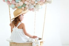 Charming child girl in a fairy magic hot air balloon Royalty Free Stock Image