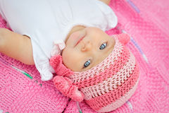 Charming child. Little girl in white knitted bear hat Royalty Free Stock Photography
