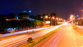 Charming city night. Urban landscape, outdoor night, street lamp with light radiation, the flow of light produce light path, dynamic, beautiful and charming Royalty Free Stock Image